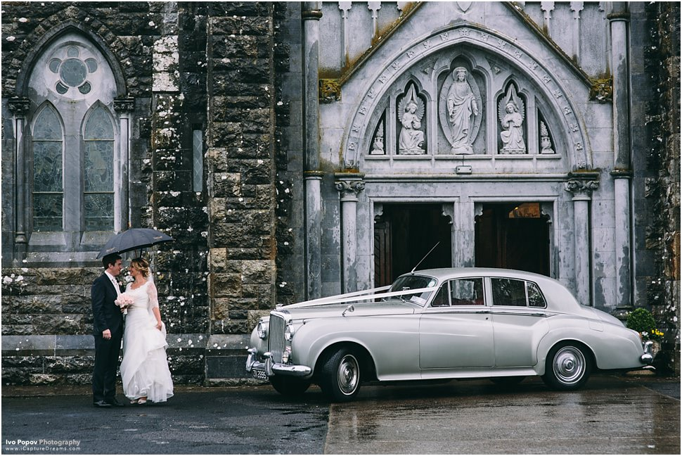 Wedding Portraits outside church in Emly in the rain
