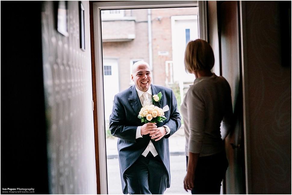 Groom bringing flowers to the bride in Aalst, Belgium