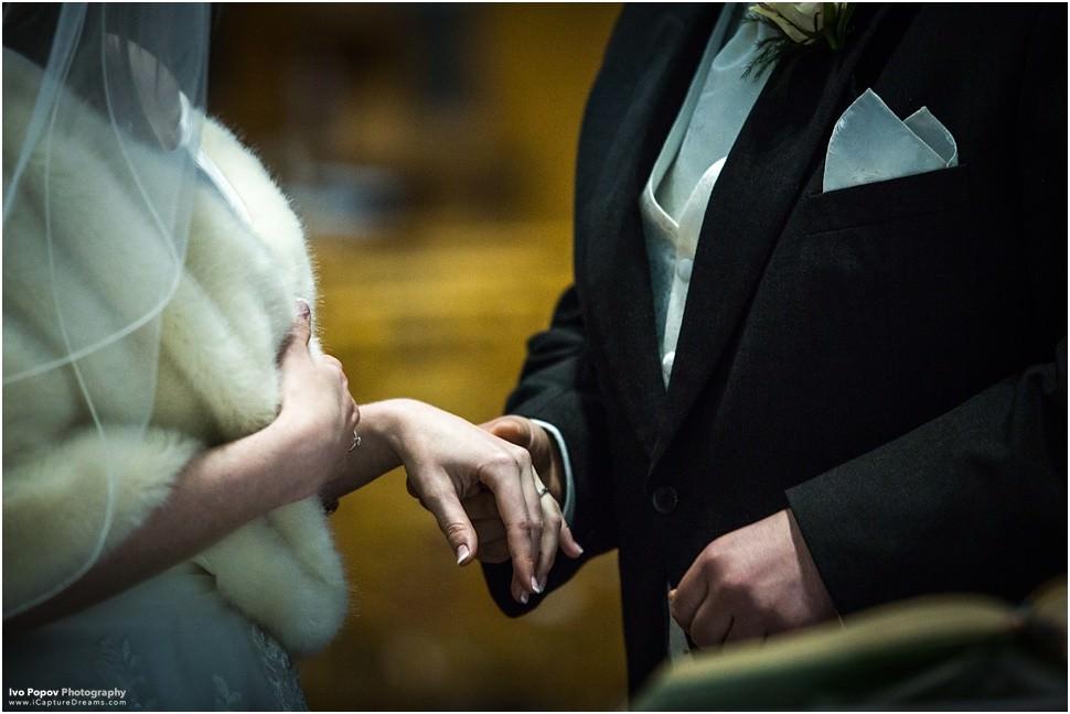 Groom giving bride the ring in Belgium