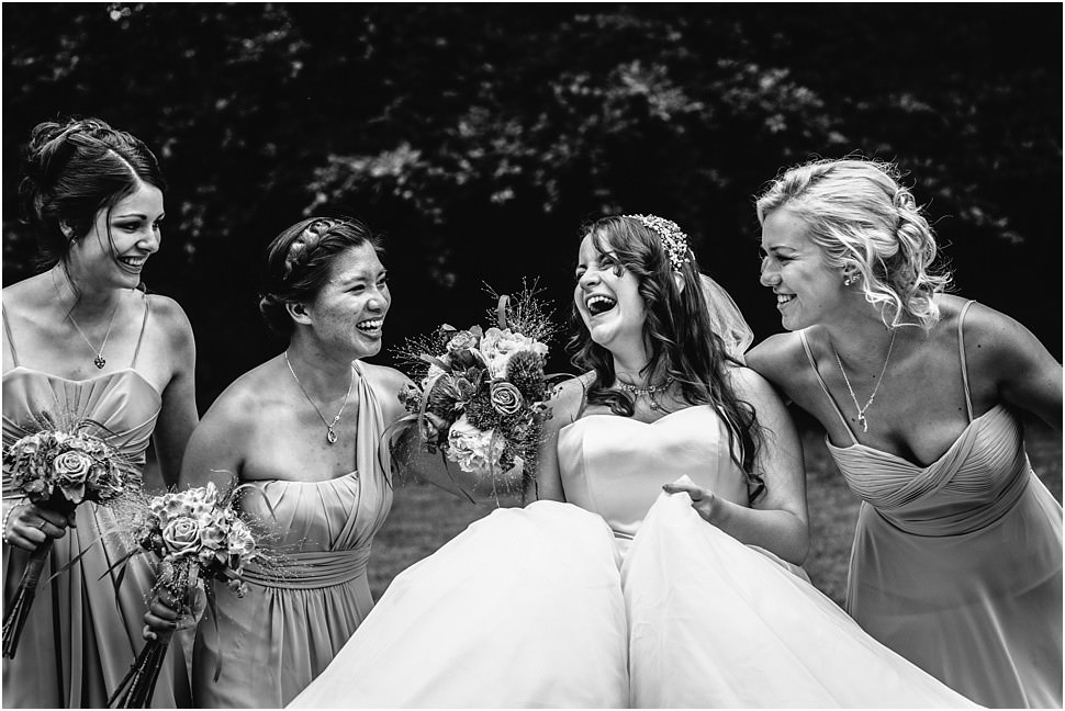 Bridal party laughing during the photo shoot in Zandhoven, Belgium
