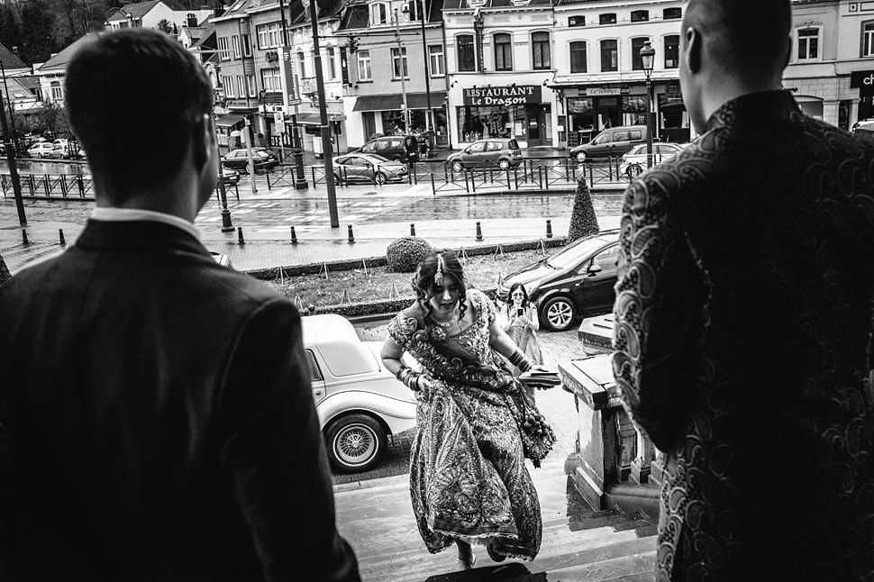 Bride running to meet her groom in Uccle