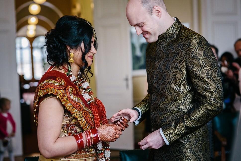 Bride and groom exchange rings in Watermael