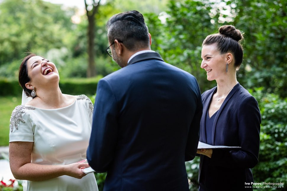 Bride laughs during elopement ceremony in Paris